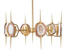 Natural agate slices and satin brass make this show stopping chandelier a statement piece.  Chic, sexy and totally unique!