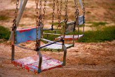 worn but still colorful swings by MROEDEL