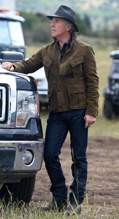 Hap Briggs (Don Johnson) wearing a Burberry XO Barneys New York Nubuck Field Jacket in Olive on Blood & Oil.