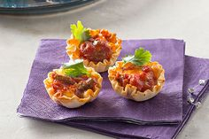 The best party appetizers aren't just tasty—they're easy to eat. These flaky phyllo shells filled with cheesy salsa dip get high scores on both counts.