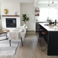 Living room, modern fireplace, simple, black island, neutral, floating shelves, IKEA chairs, renovation,  fixer upper, before and after, fiddle leaf tree Fiddle Leaf Tree, Fixer Upper House, Ikea Chairs, Modern Fireplace, Get Ready, Floating Shelves, Charity, Neutral, Homes