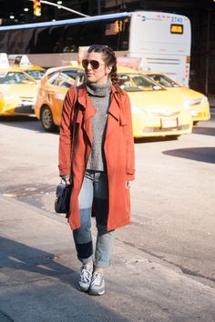 {Orange You Glad It's Spring | Simply Audree Kate} Bright trench coat with a cozy gray turtle neck sweater and patch jeans