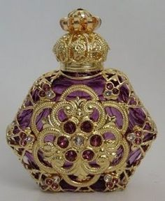 Purple glass decorated with gold filigree  Beautiful on a tray on the dressing table