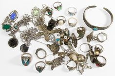 Lot 546: Sterling Silver Jewelry Assortment; Including necklaces, rings, bracelets, pendants and pins with some having semi-precious gemstone insets