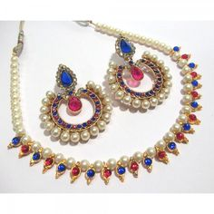 Buy Pink and Blue Round Stone Tilak Pearl Polki Necklace Set Online at cheap prices from Shopkio.com: India`s best online shoping site