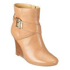"Almond toe wedge bootie.  Exposed side zipper closure.  Strap and buckle detail.  Stacked 3.5"" heel.  Leather upper."