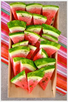 Cut a ripe watermelon into big wedges, then sprinkle with sea salt, freshly ground black pepper, and finely chopped mint.