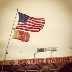 Shot of a tailgating flag in front of Jack Trice stadium