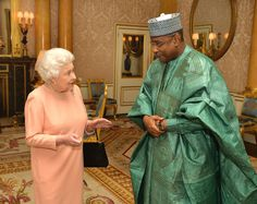 Queen Elizabeth II with Mr Abderahamane Assane Mayaki the Ambassador of the Republic of Niger during a private audience as he presents his credentials at Buckingham Palace on March 26, 2014 in London, England.