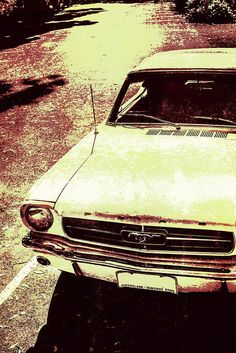 Rusty automotive photo of a vintage Ford Mustang with grain in tones of yellow and red. Classic cars by Jorgo Photography - Wall Art Gallery