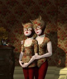 Ray Caesar. I like; the patterned shirts/along with the same pattern on the wall/red pants match the red color in the pattern