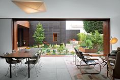The second dining room, which also appeared in Dwell, manages to include a roof for inclement weather but the wide open panels mean warm months can mimic the feeling of dining al fresco.