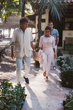 Elizabeth Taylor and Richard Burton on location in Puerto Vallarta, Mexico, while Burton was filming The Night of the Iguana, directed by John Huston. Stanley Baker follows the couple.