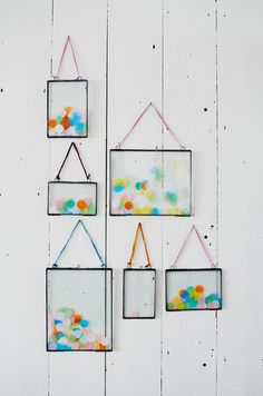 Sprinkle confetti into picture frames and hang 'em up.
