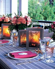 Great IDEA!!! Photo Candle Centerpiece Let you and your groom's happy faces shine with a set of photo frame lanterns for your centerpieces. They consist of three hinged photo frames set around votive candles. The black-and-white photos are printed onto ecru-colored vellum paper, which is translucent enough for the images to be visible by candlelight.