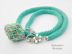 Turquoise crocheted necklace whit chunky pendant