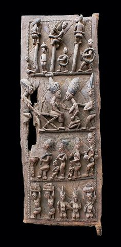 Africa | Palace courtyard door carved with high relief figures depicting palm wine tappers and other scenes of village life. | By Yoruba master carver, Olowe of Ise, ca. 1916 - 1918