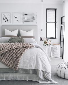 Gray is the new white! Love the way this color is paired with serene tones for a calming bedroom decor.