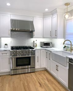 Shaker cabinetry with stainless steel appliances and brass hardware. White Shaker Kitchen, All White Kitchen, Pantry Design, Kitchen Design, Kitchen Ideas, Modern Farmhouse Kitchens, Home Kitchens, Bathroom Cabinetry, New Home Designs