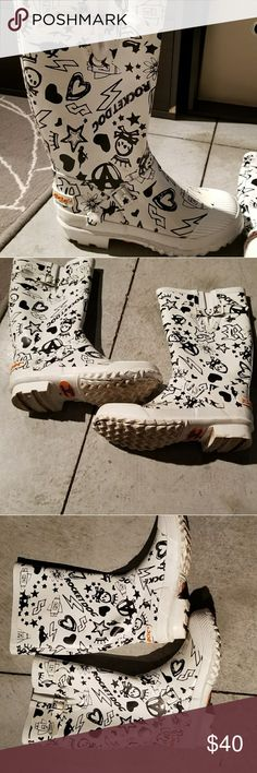 Rain boots Rocket Dog rain boots. Awesome  tread on the bottom. very sturdy. Great condition. Rocket Dog Shoes Winter & Rain Boots