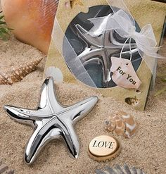 Starfish Favor Bottle Openers (FashionCraft 4870) | Buy at Wedding Favors Unlimited (http://www.weddingfavorsunlimited.com/starfish_design_bottle_openers.html).