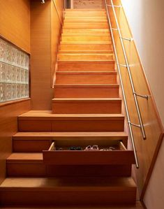 Storage stairs in Courtyard House by Studio Junction, Remodelista - one of the first things i've seen that REALLY makes me interested in buying (and customizing) a home....