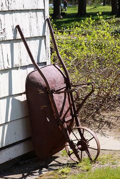 Old iron wheel wheelbarrow- have this check out the front yard!