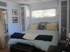 Decorating A Tiny Master Bedroom - shelves as side tables with lamps secured to cabinets