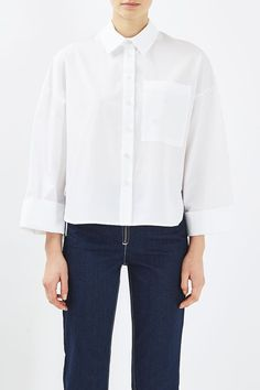 Boutique knows how to transform a wardrobe staple into a truly unique piece. This white cotton shirt comes with wide cuffs, a split to the sides and rouleau detailing a the side seams. Made in Britain. #Topshop