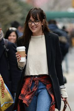 Dakota Johnson is so New York here -- with her coffee, her jeans, her dog, and stylish glasses. http://thestir.cafemom.com/beauty_style/188938/20_glasseswearing_celebrities_who_rule