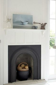 Have a non-working fireplace? It's the perfect place to display seasonal decoration!