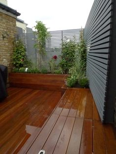 garden screens ideas - hardwood deck roof terrace privacy screen raised planter
