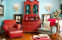 asian living room by Mina Brinkey, Wall paint: Seaside Blue, Benjamin Moore, Chinese red Chinoiserie secretary, Foo dog, turquoise and red.