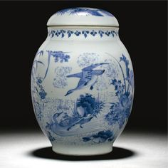 A GOOD BLUE AND WHITE `LOTUS POND' JAR AND A COVER  QING DYNASTY, SHUNZHI PERIOD