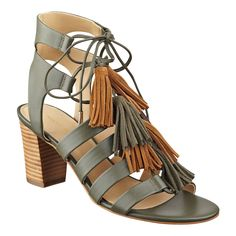 The Playful features a distinct stacked heel and multi-colored fringe lace up straps.