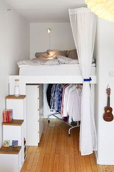 Living in a tiny apartment? Short on closet space? Here's a clever way to make a walk-in (yes, walk-in!) closet in your small apartment, and create a cozy spot for sleeping at the same time.