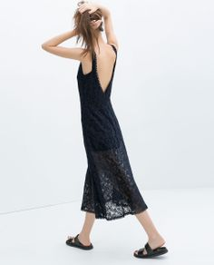 of DRESS WITH FLOUNCY SKIRT from Zara