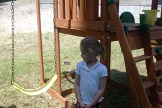 Bella sharing her swing with Lilli