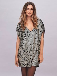 Pop Goes The Party Dress | This effortless mini shift dress features allover sequin embellishment detailing with short dolman style sleeves and a V-neckline. Lined.