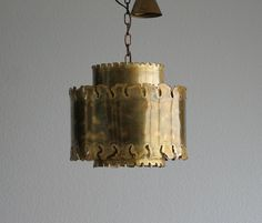 A Holm Sorensen brutalist large flame cut ceiling pendant light in oxidized brass, designed by Sven Aage Holm Sørensen and produced by Holm