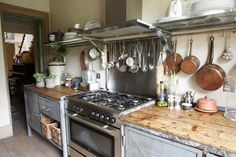 Kitchen with hanging stuff in arms reach, I like it