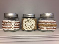 Cute Lace and Burlap decorated mason jars.  Accented with twine, crochet, and buttons.  Wedding centerpiece or shabby chic home decor.  Available on Etsy