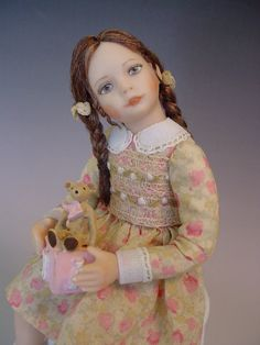 Porcelain Dollhouse Doll - Little girl with teddy on an alphabet block toy by Debbie Dixon-Paver.