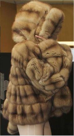 .hooded fur coat