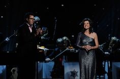 "Vince Gill backs up wife Amy Grant on ""Breath of Heaven"" during the 2011 ""CMA Country Christmas"" on ABC-TV (12/1/11)."