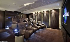 The home cinema room has soundproofed walls, reclining cinema seats with steel reading lamps and food trays