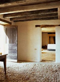 medieval farmhouse in the French village of Perigord Nord. stone floor, beamed interior;.