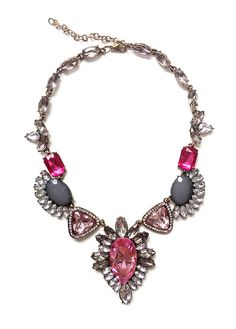 Pink statement bib necklace with a pear-shaped pink faux gemstone encrusted with white rhinestones as the centrepiece.    Size of pendant charm