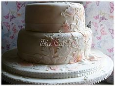 Hues of pink, white and peach to match the tulips and peonies cut out and placed on this simply beautiful brides cake.