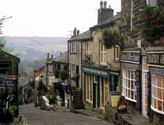 visitheworld: The beautiful village of Haworth, where the Brontë sisters lived, Yorkshire, England (by JauntyJane). enchantedengland: Reason Number to visit Yorkshire. Yorkshire England, England Uk, West Yorkshire, Northern England, Travel England, Great Places, Places To See, Amazing Places, Beautiful World